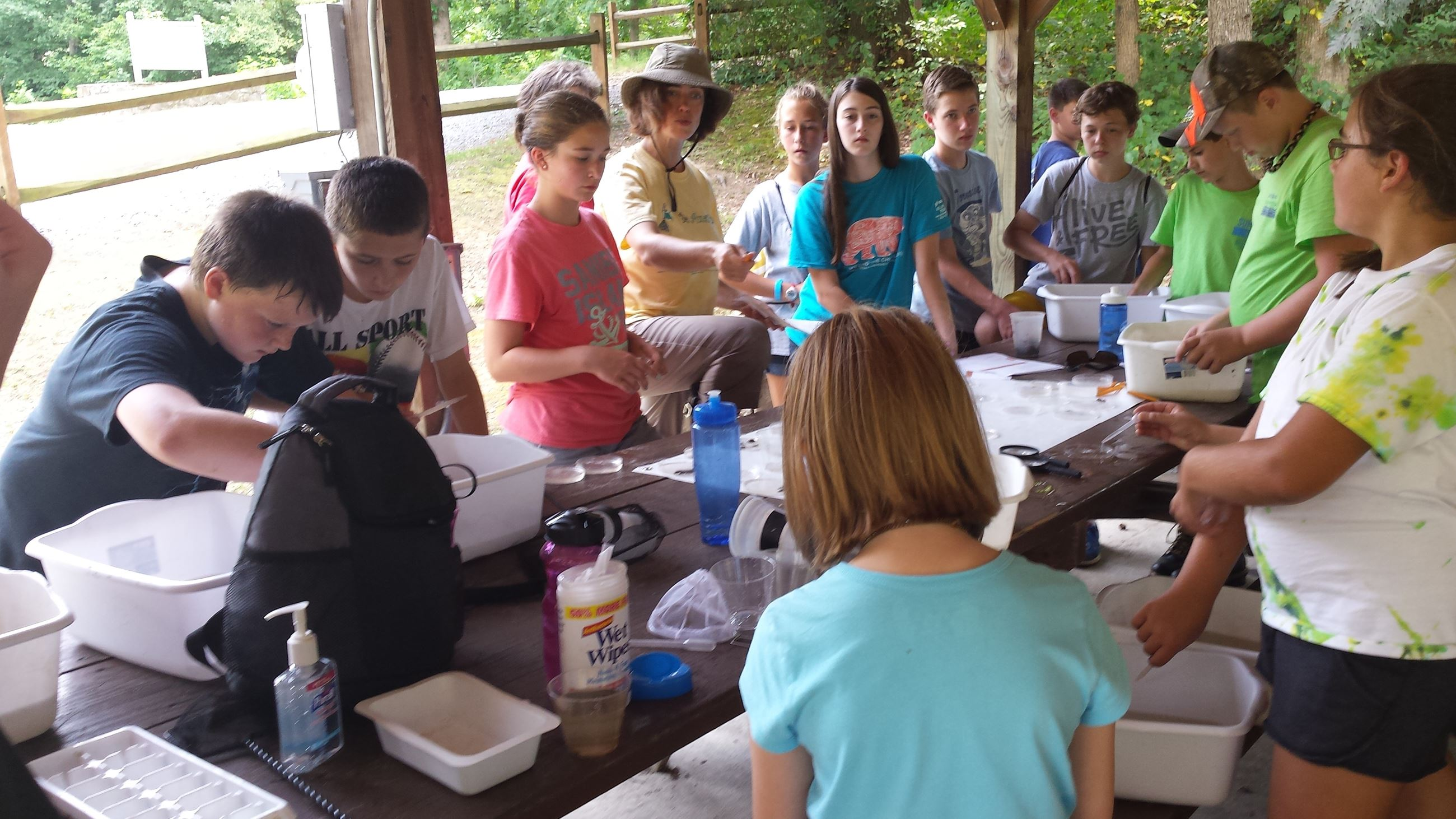 Kids doing experiments during summer environmental camp