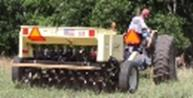 Person planting with the Truax no-till drill - back view